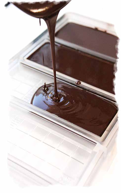 Pouring tempered chocolate into the moulds